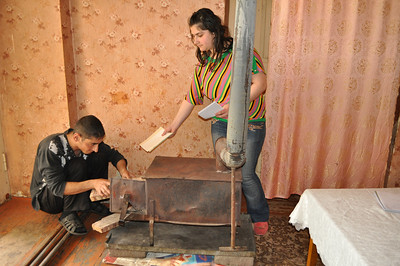 Artyom and Tsovinar with their heater, photo by Levon