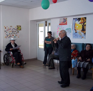 Yerevan State Conservatory Professor Armen Budaghyan playing fife (flute) at the Vanadzor Old Age Home